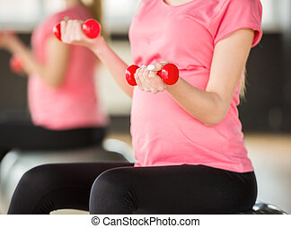 Pregnant woman. Fitness.