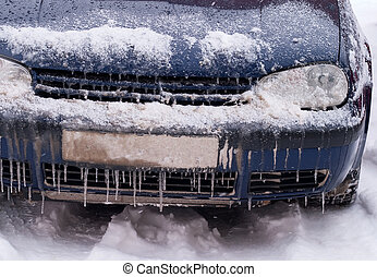 Frozen car covered with snow and ice