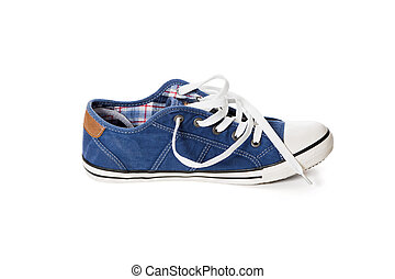 Blue athletic shoe - Side view of blue athletic shoe with...