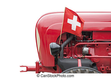 Tractor - Old red tractor with swiss flag and isolated on...