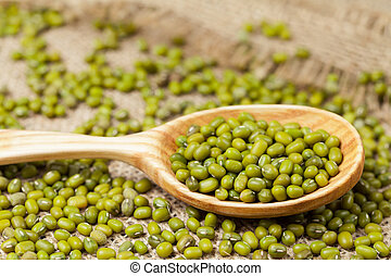 Heap of natural raw mung beans healthy clean foods in spoon