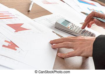 Businessman analysing graphs - Businessman analysing...