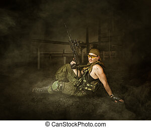 Military man soldier Holding automatic machine gun and...