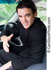 confident businessman in car - a confident young businessman...