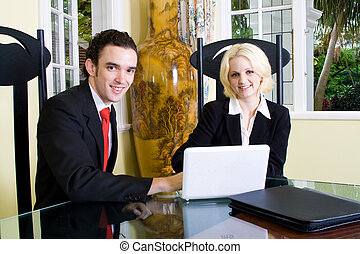 realtor meeting - a realtor having meeting with client using...
