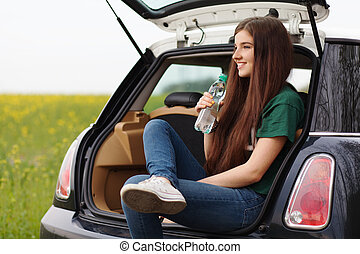 Young woman on a road trip