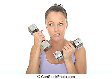 Healthy Young Woman Training With Weights Looking Fed Up -...