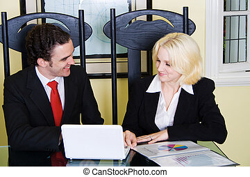 realtor - a realtor and client discussing business with...