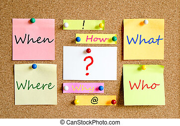 Questions Concept - Colorful sticky notes on cork board...