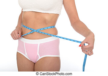 Healthy Young Woman Checking Her Weight Loss With a Tape...