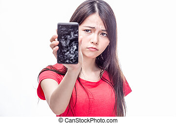 Chinese woman cracked cell phone - Frowning Chinese woman...