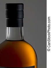 golden Cognac - detail of a bottle of cognac - bottleneck,...