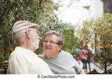 Senior Couple on Bench in the Market Place
