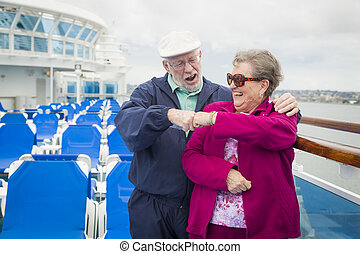 Senior Couple Fist Bump on Deck of Cruise Ship