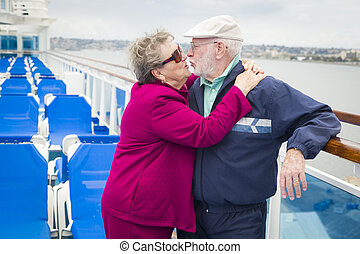 Senior Couple Kissing on Deck of Cruise Ship