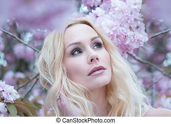 Gorgeous dreamy young woman in spring