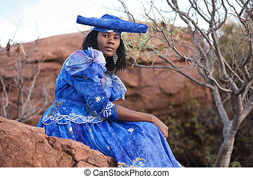 herero african girl with traditional clothing, hairstyle and...