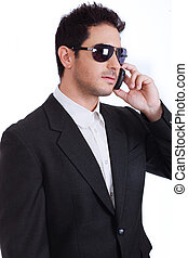 Young attractive business man on the phone