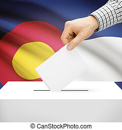 Ballot box with US state flag on background - Colorado -...