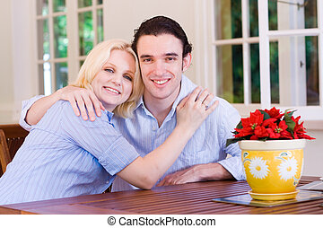 lighthearted couple - a lighthearted young couple at home on...
