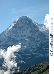 Eiger with sun and clouds