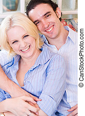 love couple - a love couple snuggling and laughing together