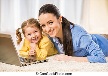 Mom with little daughter - Young mother and her adorable...