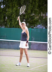 Portrait of Exclaiming Professional Tennis Player On Court...