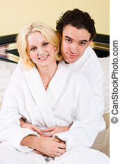 couple in love - a young couple hugging in bathrobes in the...