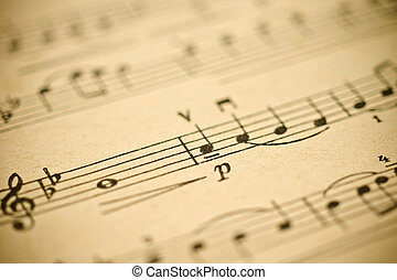 Classical music - notes on yellowed vintage paper sheet...