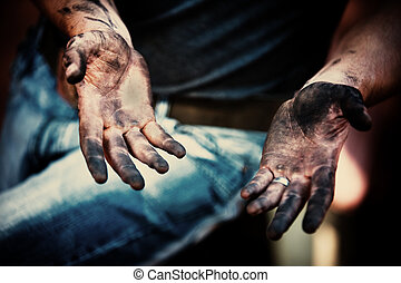 working hands - mechanic with dirty hands after fixing the...