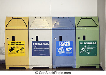 Waste separation - Four side by side garbage cans made of...