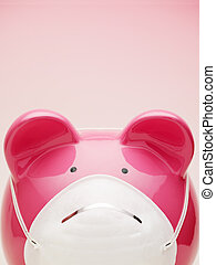 piggy bank with protective mask. Copy space