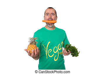 Fully vegan - Man with a carrot in his mouth is standing in...