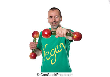 Vegan und sporty - A man with dumbbells standing in front of...