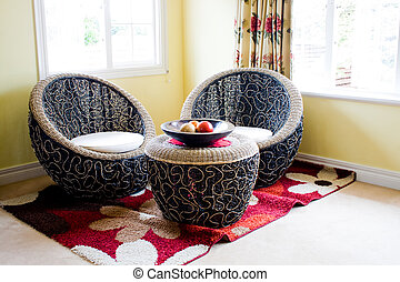 living room with chairs made of vine