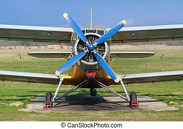 Vintage biplane - Biplane with blue blue propeller Old plane...