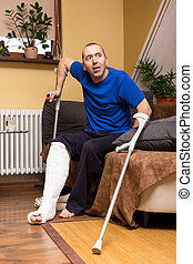 Difficulties with a leg in plaster - A man with a broken leg...