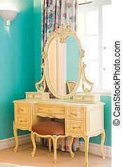antique dresser  - an antique dresser near a window