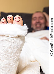 Funny toes - Toes looking out the of a plaster painted with...