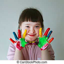 Cute little girl with painted hands Isolated on grey...