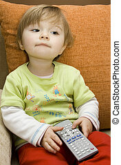 baby girl with remote control