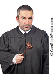 Serious male judge - A serious male judge holding the gavel,...