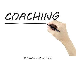 coaching word written by man's hand