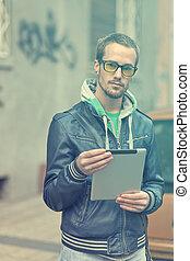 Man On Street Use Ipad Tablet Computer
