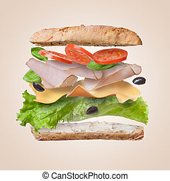 Sandwich with falling ingredients in the air - slices of...