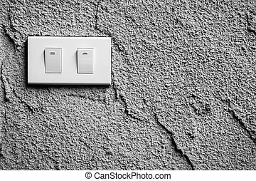 black and white of light switch on wall