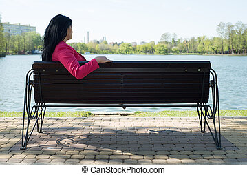 Solitude woman on bench in park