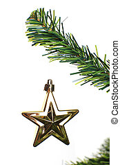 christmas star ornament hanging from a xmas tree branch