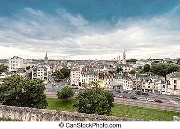 Caen, France. Aerial cityscape at dusk.